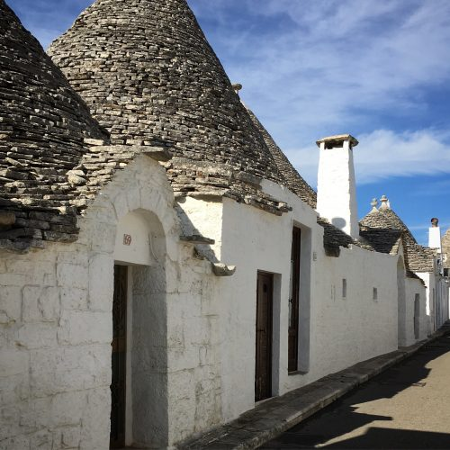 the conical rooves of the rustic trulli houses, found worldwide but never as elevated as here in Alberobello
